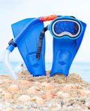 Mask, fins and tube in sand background Stock Images