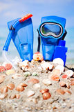 Mask, fins and tube in sand background Stock Image