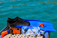 Mask, fins, underwater camera, starfish on the sea background. Stock Image