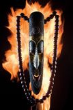 Mask on fire. An illustrated background of an African mask on fire Royalty Free Stock Image