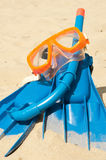 Mask and flippers on a beach. Mask and flippers on a sand stock image