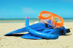 Mask and flippers on a beach. Mask and flippers on a sand beach stock photo