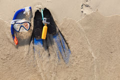 Mask and flippers on sand Royalty Free Stock Photo