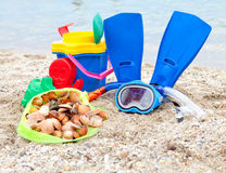 Mask flippers seashells on a sandy beach Stock Photos