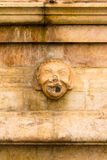 The mask on the fountain, Old City of Jerusalem.  Stock Photo