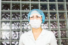 Mask and goggles protected life science researcher observing. Focus on scientist`s eye. Health care and biotechnology Royalty Free Stock Photos