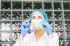 Mask and goggles protected life science researcher observing. Focus on scientist`s eye. Health care and biotechnology. Concept Stock Photography