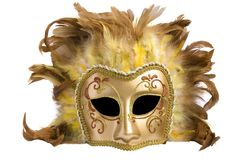 Mask from a golden  paper and feathers Stock Image