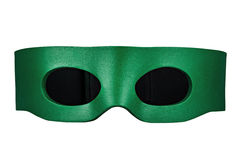 Mask green for a party and carnival. Isolated on white background Stock Images