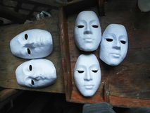 Mask. Group of the white masks is also unfinished on a wooden desk Royalty Free Stock Image