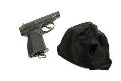 Mask and gun on white Royalty Free Stock Image