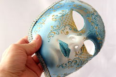 Mask in hand Royalty Free Stock Photography