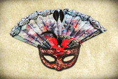 Mask and Hand Fan Stock Photography