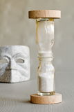 Mask and hourglass Royalty Free Stock Image