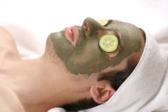 Mask II. Someone having a mud mask in a spa with cucumbers Stock Images