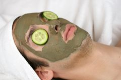 Mask III. Someone having a mask in a spa with cucumber slices on the eyes Stock Images
