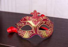 Mask for masquerade. On the table royalty free stock photo