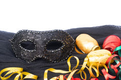 Mask with masquerade decorations. Mask with masquerade curling paper border over white background with copy space stock photos