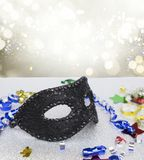 Mask with masquerade decorations. On silver background with copy space royalty free stock images