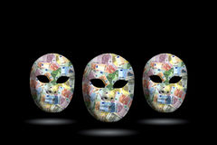 Mask with money. Three mask with money face in black background Stock Photos