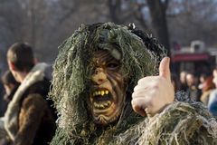 Mask Mummer Surva Bulgaria monster river. Surva 2016, Pernik, Bulgaria Surva, the International Festival of Masquerade Games is the biggest event of this kind in royalty free stock photography