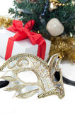 Mask over Christmas decoration Stock Image