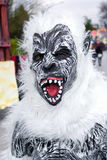 Mask at a parade of Carnival floats. Parade of Carnival floats during the Carnival of Saviano, Italy, March 9, 2014 stock image