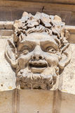 Mask Place Vendome Paris. A theatrical mask on the facade of a historical buidling in Place Vendome, Paris Royalty Free Stock Photo