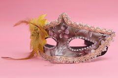Mask for Purim celebration jewish carnival holiday and glitter background. se. Carnival background with mask, serpentine and confetti. View from abovenPurim Stock Photography