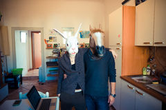 Mask rabbit and horse couple in love Stock Photography