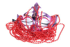 Mask and red beads Royalty Free Stock Images
