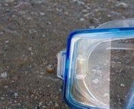 Mask on sand Stock Image