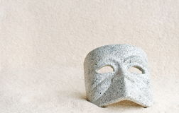 Mask in sand Royalty Free Stock Photo