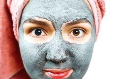 Mask for skin woman, closeup portrait of a happy girl with mask for skin, girl is smiling stock images