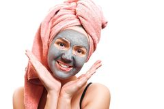 Mask for skin woman, funny and happy girl with facial mask on a white background, photo, girl is smiling and looking at royalty free stock image