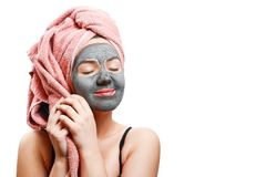 Mask for skin woman, girl enjoys a mask for face skin, isolated photo, closed eyes with pleasure stock photo