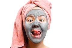 Mask for skin woman, girl puts out her tongue, girl tries face mask on taste, funny slanting eyes, funny girl, photo stock photos