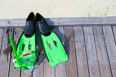 Mask, snorkel and fins for snorkeling on wooden Royalty Free Stock Photos
