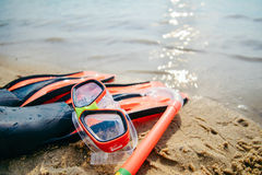 Mask with snorkel and flippers on the beach Stock Photos