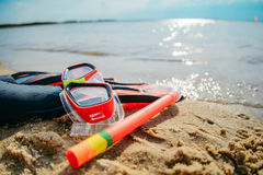 Mask with snorkel and flippers on the beach Stock Image