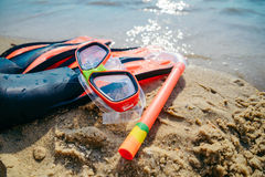 Mask with snorkel and flippers on the beach Royalty Free Stock Photography