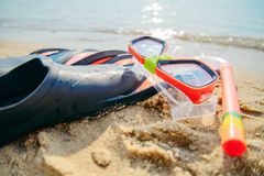 Mask with snorkel and flippers on the beach Stock Images