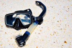 Mask and snorkel. On a pebble beach in Greece Royalty Free Stock Photo