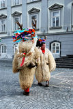 Mask taken down. Kurent or korant is a traditional carnival mask, dressed in fur and special headgear, with cow bells. Jumping and dancing and making noise they Royalty Free Stock Photography