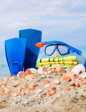 Mask,towel seashells and tube against blue sky Stock Images