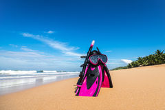 Mask with tube for snorkeling and flippers on the beach Royalty Free Stock Images