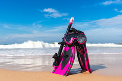 Mask with tube for snorkeling and flippers on the beach Royalty Free Stock Photos