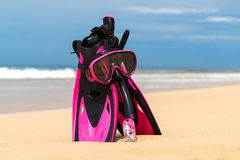 Mask with tube for snorkeling and flippers on the beach Stock Photos