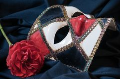 Venetian mask. With a red rose Royalty Free Stock Photos
