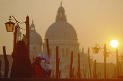 A mask in Venice Carnival. A mask in the sunset light of Venice Stock Photography